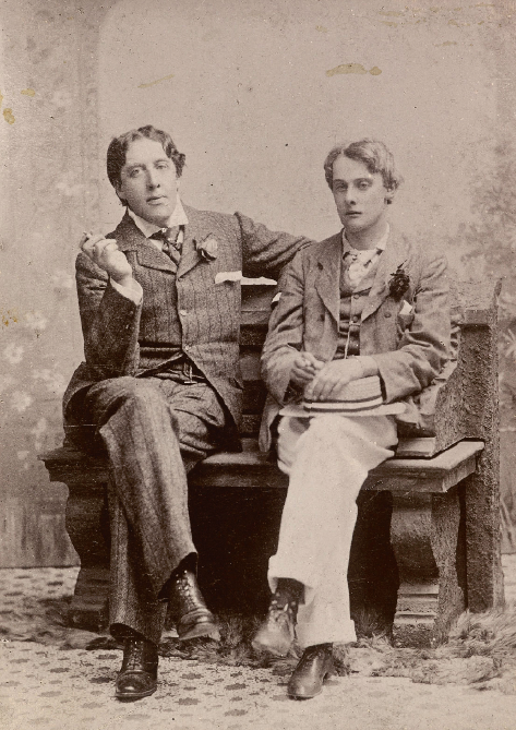A charming and poignant photograph of Oscar Wilde and Lord Alfred Douglas. In England, it was Wilde himself who was identified as central to the English decadent tradition, along with Arthur Symons and the poet Ernest Dowson. Wilde was important because of his high visibility in fashionable London clubs and theatres. He dressed flamboyantly, sparking fashions that others copied. He was a brilliant self-publicist, and quipped that his life was a work of art. Courtesy Carolyn Burdett, article Aestheticism and decadence